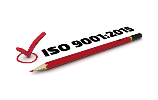 "The mark ""ISO 9001:2015"". Red pencil and mark on white surface"